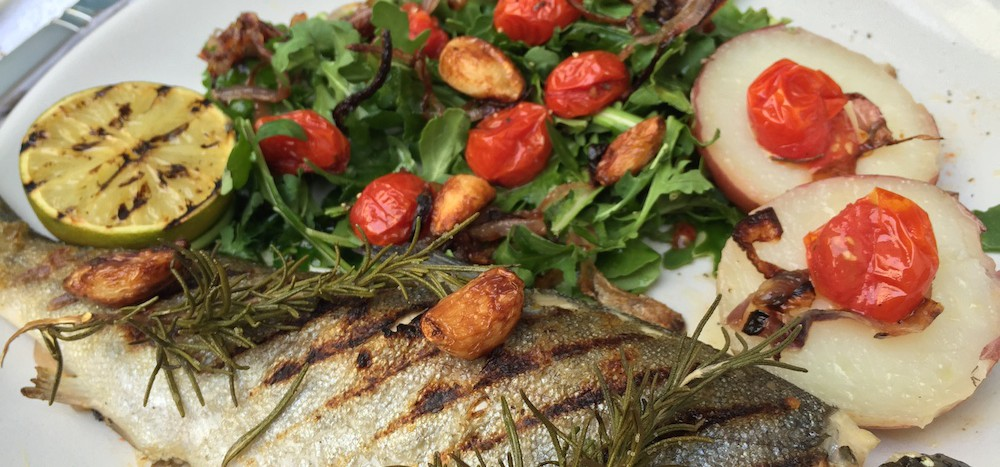 charred trout rosemary potatoes roasted cherry tomato, crispy red onion rocket salad