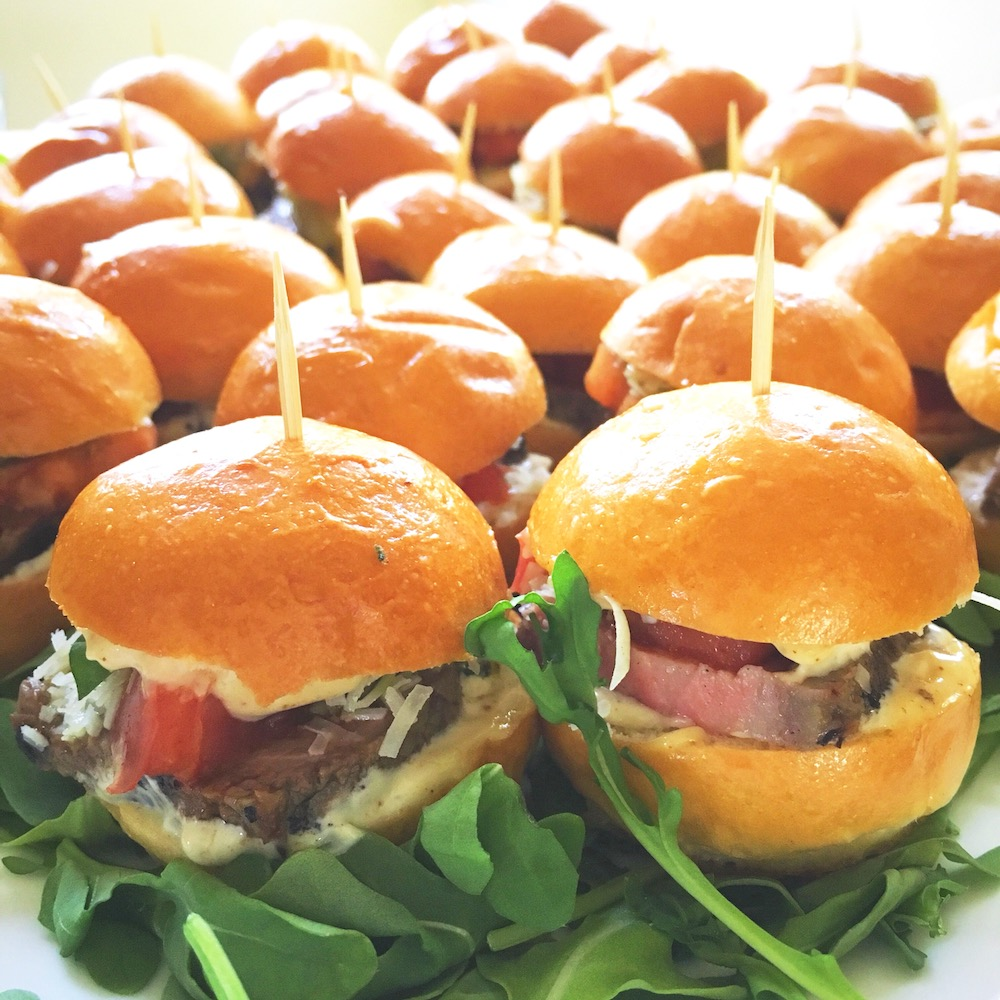Mini-sliders-with-slow-roasted-beef-homemade-aioli-homemade-pesto-heirloom-tomato-marinated-in-smoked-paprika-&-balsamic-and-aged-Parmesan-cheese